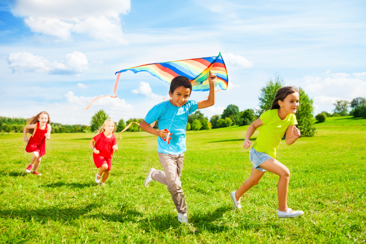 kids running with a kite